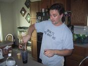 "There&#146s my brother, polishing off a gallon of rum it looks like.....lush. Note the ""Drink til you want me"" shirt."