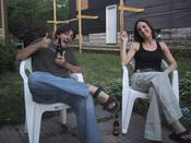 Sitting in my back yard with my friend Saisha, enjoying my lovely Xingu beer.