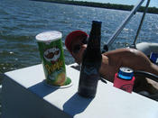 Pringles seemed to be the perfect companion to a cold barley wine on a pontoon in a minnesota lake. But who&#146s that bozo in the background.