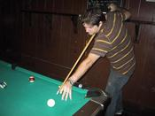 Adam shooting some pool. he actually made this shot. unbelieveable.
