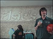 Here&#146s me enjoying a glass of good stuff in front of the elsies sign